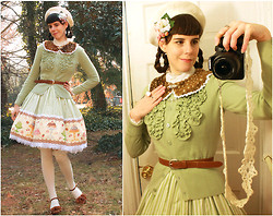 "Tyler H - Van Husen Mint Ruffle Cardigan, Lily Of The Valley ""Excerpts From A Victorian Cookbook"" Jsk, Bodyline White Socks W/ Pink Polkadots, White Beret, My Own Work Tatted Camera Strap, Thrifted Tan Belt, My Own Work Fawn Collar, Vintage Rhinestone Brooch, My Own Work Strawberry Corsage, Ebay Chiffon Blouse, Thrifted Caramel Heels, My Own Work Shoe Bows - Carnival sweets"