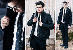 Chris Nicholas - Penguin Tie, H&M Bomber, Kenneth Cole Bag, The Tie Bar Gunmetal Clip - Penguins