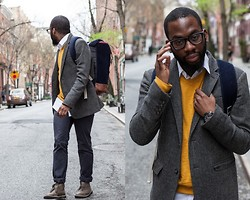 McArthur Joseph - Brooks Brothers Sweater, American Eagle Jacket, Hex Backpack, Clarks Boots - Colonel Mustard