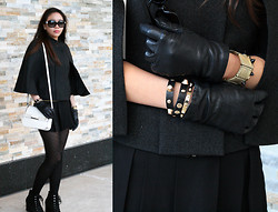 Trinh Q - Chanel Sunglasses, Zara White Studded Side Bag, Le Chateau Suede Laced Up Ankle Wedges, Forever 21 Gold Trimmed Skort, Holt Renfrew Black Leather Gloves, Mango Gold Elastic Mesh Braclet, Bcbg Gray Chic Poncho - Looking Chic in a Poncho