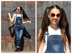 Rosalie Green - Bib Overalls, Very Round Sunglasses, Tartan Shoes And Socks, Tartan Belt - Bib overalls come out of the garden
