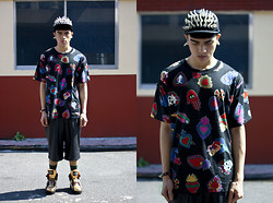 Paul Jatayna - Joyrich X Giza Symbol Shirt, Mogul Leather Shorts, Solestruck Gold Sneakers, Os Accessories Overbite Cap, Os Accessories Dogtooth Earring - THEBRAINWASHER