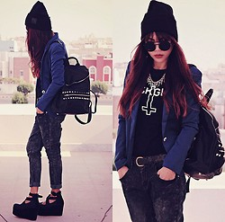 Bernadette F - Girl Division Logo Beanie, Smiling Face Round Sunglass, Cross Pendant Necklace, Blazer, Cross Print T Shirt, Studded Bucket Backpack, Acid Wash Jeans, Velour Strappy Platform - GIRL DIVISION