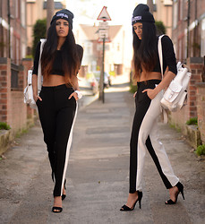 Kavita D - Choies Monochrome Stripe Pant, Ebay Black Sandal Heels, Grafea White Rucksack, Missguided Black Crop Top, Comme Des Garçons Fuckdown Beanie - Now get this work.