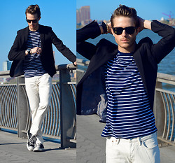 Adam Gallagher - Ray Ban Wayfarer, Similar Here  > Black Blazer, Similar Here  > Stripe Shirt, Similar Here  > Jeans - It's clear