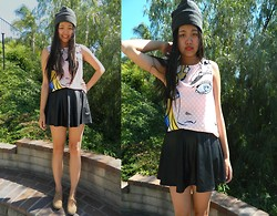 Joanna Tam - Beanie, Comic Tank Top, Leather Skirt, Oxfords - Comic Relief.