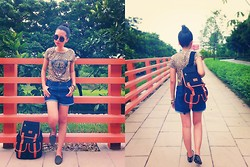 Xi Voon Tan - Leopard Print Tee, Pretty Little Things Star Studded Denim Shorts, Vincci Black Spiked Suede Loafers, Black Backpack, Pretty Little Things Black Round Sunglasses, Assorted Bronze Bangles, Diva Gold Metal Geometry Ring - Roaring Vintage