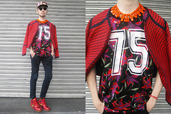 Andre Judd - Zara Floral Print Tee With Jersey No., Yhansy Orange Coated Neckpiece, Lespecs Rudeboy Frames, Sm Brocade Jacket, Custom Made Ankle Denim Trousers, Nike Metallic Red Sneaks, Floral Print Cap - RED RACER