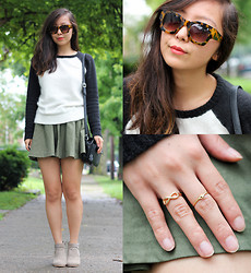 Angie C - Thrifted Baseball Sweatshirt, H&M Olive Green Flare A Line Skirt, Ragorama Tortoise Shell Sunglasses, Urban Outfitters Dainty Midi Rings - She pitched baseball tees to Sporty Spice