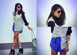 Naina Kamath - Seekers Of Style Blouse, Speedo Sporty Shorts, Sears Chunky Heels, Triangl Metallic Bag - Mon Bleu Militaire