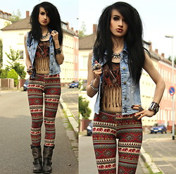 Tessa Diamondly - Tally Weijl Destroyed Acid Wash Denim Vest, Topshop Fringed Biker Top, Forever 21 Necklace, Truly Madly Deeply Ethnic Elephant Print Leggings, Ash Footwear Studded Boots - Times are looking grim these days, holding on to everything.