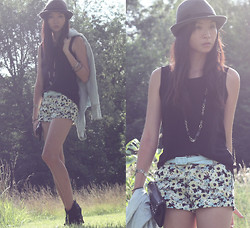 Sabrina Kwan - Leather Booties, Floral Shorts, Denim Jacket, Studded Clutch - Dark florals