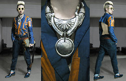 Andre Judd - Accessory Street Tribal Neckpiece, Cessa Wood Round Oversized Frames, Edgar Buyan Cut Sewn Leather And Denim Blazer With Cutout Back, High Waisted Carrot Fit Pleated Denim Trousers - BACKSTORY