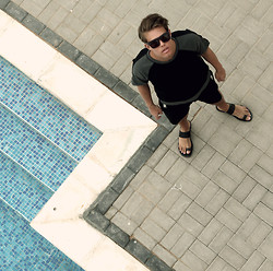 Andreas Wijk - Acne Studios Sandals, Cos Shorts, & Other Stories Sunglasses - By the pool