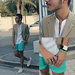 Ali Al-Bana - Abercrombie & Fitch White Linen Shirt, Ali Al Bana Custome Beige Collar Studded Blazer, H&M Turquoise Colored Shorts, Zara White Sneakers, Kenneth Cole Beige Silver Watch, Forever 21 Turquoise Precious Stoned Ring - Block 338, Adliya..