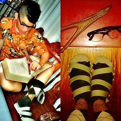 Atanaki Rai G - Abstract Floral Printed Collar Shirt, Scuba Vintage Brown Socks, Toetoe Gladiator Slipper, Png Woodcarved Crocodile Rubber Sling - Finding the right term