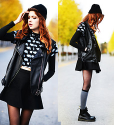 Ebba Zingmark - Bellevior Vest In Pu Leather, Motel Rocks Shirt With Eye Print, Motel Rocks Polo Top, Motel Rocks Skater Skirt, Da Sein Knee Socks, Dr. Martens Boots, Monki Beanie - Now love is all I've got