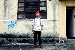 Nick C - Gram 390 G Red Rust & Tigerstripe Hi Tops, Browny Vintage Text Print Shirt, Wego Camo Print Backpack - Dark Collective