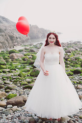 Megan McMinn -  - The bride wore white.