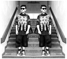 Rei Hontanar - Comax Star Spangled Shirt, Black Shirt, Ray Ban Shades, Drop Crotch Shorts, Converse Sneakers, Salvatore Mann Leather Bag - Comme des Givenchy