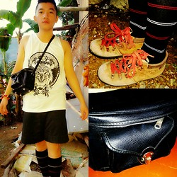 Atanaki Rai G - Crazymaggot's Clothing Sleeveless In Black And White Eagle Print, Leather Black Messenger Bag, Bench Socks In White And Red Stripes, Bally Vintage Boots - The Primitive Messenger