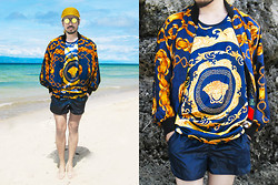 Andre Judd - H. Custodio Chain Print Silk Bomber Jacket, Androgyne Manila Silk Tank, Nylon Shorts, Perforated Steel Round Frames - THE ROYAL BLUE