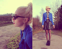 Julez . - Sunglasses, Blue Leather Jacket, Black And White Crop Top - Messy bun