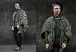 Andre Judd - Silver Id Chain Neckpiece, Olive Ruched Cape, Olive Waxed Button Down Shirt, Perforated Mesh Flip Frames, Trilby, Olive Monk Straps - OLIVE COUTURE