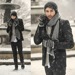Adam Gallagher - Similar Here  > Cardigan, Beanie, Similar Here  > Scarf, Similar Here  > Rain Boots - Wintry