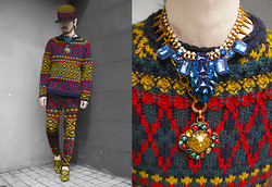 Andre Judd - Knit Pullover, Reworked Knit Pullover Made Into Pants, Reworked Knit Cap, Gglamorosa Lion Brooch, Christopher Munar Blue Crystal Neckpiece, Filigree Embroidered Velvet Slippers - KNITTY GRITTY