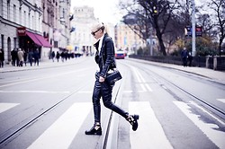 Victoria Törnegren -  - Over the street in leather.