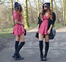 Kavita D - Comme Des Garçons Fuckdown Beanie, Zerouv Oversized Sunnies, New Look Oversized Boyfriend Coat, Glamorous Red Ditsy Floral Playsuit, Dr. Martens Dr - The Floral Trend : Grunge