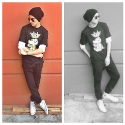 Brandon Beltran - Ray Ban Sunglasses, Urban Outfitters Beanie, Costy Clothing T Shirt, Cotton On Pants, Converse Shoes - Costy