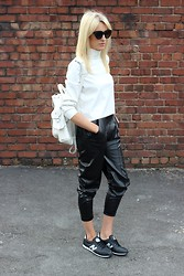 Charlotte Lewis - Grafea White Backpack, Missguided Leather Polo Top, Missguided Leather Joggers, Zerouv Cat Eye Sunglasses, New Balance Trainers - Sporty Monochrome Leather