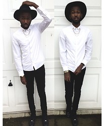 Abdulqadir Abuukar - Topman White Shirt, Zara Skinny Jeans - Lone ranger riding through an open space