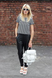 Charlotte Lewis - Vagabond White Cleated Sole Chunky Sandals, Miss Selfridge Breton Striped Top, Grafea White Leather Rucksack, Zerouv White Retro Sunglasses, Missguided Leather Tailored Trousers - Monochrome Breton Stripes and White Accessories