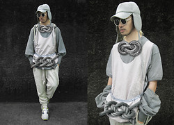 Andre Judd - Baided Metal Neckpiece, Robi Lolin Tank Top With Knit And Woven Combo, Andre Judd Heather Jersey Flap Cap, Beige Heather Jersey Oversized Joggers, Oversized Braided Rope Detail, Tough Jeans Shrug Heather Jersey Hooded Sweater With Bishop Sleeves, Heather Grey Tee, Matte Silver Round Frames, Nike Airmax 90 - BRAIDY BUNCH