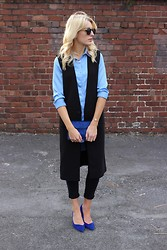 Charlotte Lewis - Frontrowshop Sleeveless Gilet, Marks And Spencer Blue Suede Court Shoes, Alice&You Blue Shirt Swing Dress, Jasmb Blue Ponyhair Clutch Bag, Zerouv Wayfarers - Front Row Shop Sleeveless Coat