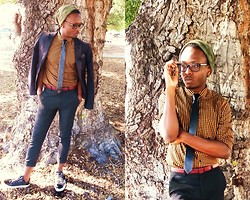 Ronald Gravesande - H&M Yellow Plaid Shirt, H&M Black Blazer, Black Leather Pocket Square, Urban Outfitters Black Leather Tie, Asos Black Trousers, Zara Burgundy Belt, Aldo Black Patent Leather Sneakers With Mesh, H&M Green Camo Print Beanie - A World of Pattern and Print
