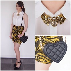 Gabby P. - Trinket Avenue Statement Gold Heart Necklace, Asos Black Quilted Heart Bag, Topshop Skirt - Make a statement in gold