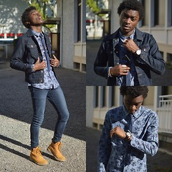 Marc-Henri Ngandu - Bizzbee Blue Jeans Vest, H&M Blue Skinny Jeans, Weinbrenner Yellow Boots, H&M Blue Skinny Necktie, New Look Blue And Maroon Flowers Shirt - Blue Spring 2