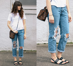 Tonya S. - Urban Outfitters White Tee, Urban Outfitters Double Strap Slingback Sandals, Ripped Jeans, Jesslyn Blake Bucket Bag - Bare Bones