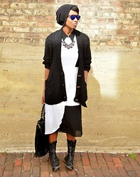 Sushanna M. - Urban Outfitters White Semi Sheer Asymmetrical Dress, Thrifted Black Semi Sheer Asymmetrical Overlay Dress, Tobi Black Oversized Knitted Deep Pocket Cardigan, Frontrowshop Black Fringe Bag W/ Gold Braided Handles, Urbanog Black Adjustable Calf Boots W/ Exposed Blue Zipper, Zerouv Blue Reflective Sunglasses - Blue In The Face