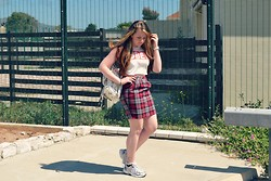 Maisie Gibbons - Charity Shop High Waisted Tartan Skirt, Obey Crop Top, Accessorize Floral Rucksack - Tartan + Trainers