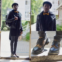 Marc-Henri Ngandu - H&M Chapeau Melon, Made By Me African Tie, New Yorker Black Perfecto, Zara Black Long Cap, Asos Black Aztec Bag, H&M Skinny Jeans, Asos Black And Leopard Shoes - African Details