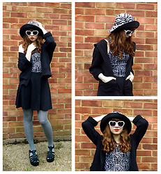 Emily May - Topshop Zebra Print Hat, Tiger White Heart Shaped Sunglasses, H&M Black Hoodie, Topshop Jungle Leaves Print Crop Top, Topshop Black Jersey Skater Skirt, Accessorize Black And White Check Tights, New Look Black Chunky Sandals - Zebra Hat