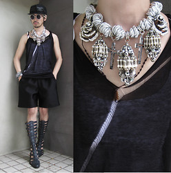 Andre Judd - Adante Leyesa Embellished Neckpiece, Rick Owens Sheer Tank With Distress Detail, Maison Martin Margiela G Shock, Don Protasio Sandals, Renan Pacson Neoprene Shorts - GOTHIC SUMMER