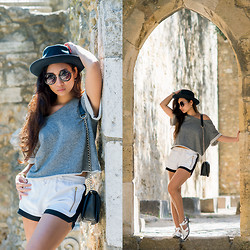 Minh Nguyen - Ivyrevel Shorts, H&M Top, Asos Shoes - Brick wall