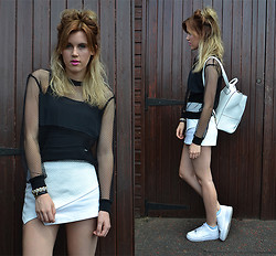 Anna - H&M Jumper, Topshop Skort, New Look Backpack, Nike Trainers - Fishnet monochrome