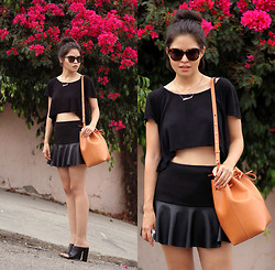 Adriana Gastélum - Karen Walker Sunnies, Mansur Gavriel Bucket Bag, Chic Wish Skirt, Fake Leather See The Rest On - It's so hot outside